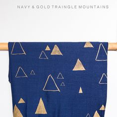 Navy linen fabric with screen printed gold scattered triangles to sit on top of my ottomans