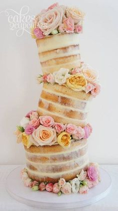 rustic naked  topsy turvy wedding cake / http://www.deerpearlflowers.com/topsy-turvy-wedding-cake-ideas/