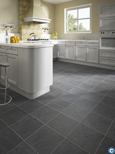 Vinyl kitchen flooring is a very popular choice by homeowners. Vinyl kitchen flooring offers many benefits to the homeowner who has children, pets, or lives an active lifestyle. These floors are ve… Laminate Plank Flooring, Waterproof Laminate Flooring, Vinyl Flooring Kitchen, Wood Floor Kitchen, Floors Kitchen, Tile Flooring, Types Of Hardwood Floors, Grey Wood Floors, Distressed Wood Furniture
