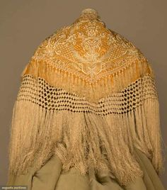 Augusta Auctions: embroidered evening cape, c. 1880. Goldenrod silk covered in ivory silk arabesque & floral embroidery, long ivory crimped fringe.   #vintage #silk