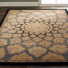 Plush Peacock Medallion Border Rug Luxurious highlights in genuine silk add opulence to this intriguing Persian peacock medallion design. The refined, dense wool pile is accented with shimmering silk for added definition to this up scaled pattern. Select from e rich color ways: coffee Brown with mocha, khaki, misty green, and oxblood accents, Gray slate with silver blue, golden umber, dusty rose and a black border, or rosy Orange brick with sea mist and sage greens, khaki and a crimson…