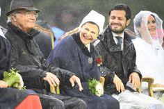 The Swedish Royal family endure a torrent of rain at the annual birthday concert honors Crown Princess Victoria. July 14, 2014: King Carl Gustaf, Queen Silvia, Prince Carl Philip and Sofia Hellqvist