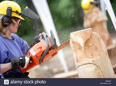 Download this stock image: A womanm treats a trunk with a chainsaw to make art in Extertal, Germany, 28 May 2010. Women are trained in the so-called 'Carving'technique to form sculptures from wood. Photo:Oliver Krato - D5900W from Alamy's library of millions of high resolution stock photos, illustrations and vectors.