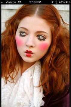 Circus makeup, I like how the changed the lip form with the red lipstick, the overuse of blush, the emphasis of lower eyes lashes using mascara