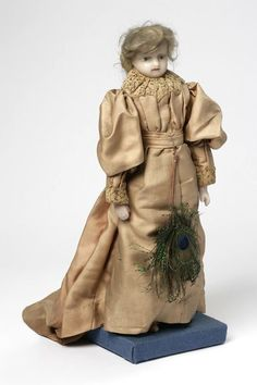1881 Doll The doll was dressed in fashionable costume by the Powell family. Letitia Clark (born 1741), who married a London merchant called David Powell (born 1725) at the church of St Botolph's Bishopsgate, London in 1761, had a hobby of dressing dolls in the prevailing fashions of her day, in some instances copying her own clothes. Her earliest one shows a dress of 1754. Letitia died in 1801 and David in 1810, but their descendants continued this tradition of dressing dolls until 1912.
