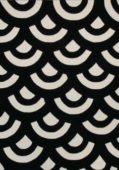 Bold black and white fish scale pattern