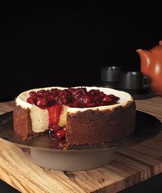 Gingersnap Cherry Cheesecake: The gingersnap crust is easy to make—just grind the cookies in a food processor, then combine with melted butter and press into a pan.