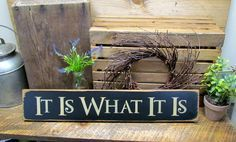 "This wooden sign is made from pine, and measures Approx 4.5""W x 26""L. It reads ""It is what it is"". The front is painted black then distressed, the back is stained with a router spot for hanging. All o"