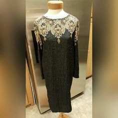 Carolyne Barton Beaded Dress Size Small Carolyne Barton Beaded Dress Size Small Evening dress in black with Gold, white & black beads.  Dress is in great condition.   Feel free to ask any questions before purchasing. Thanks for shopping my closet! Carolyne Barton  Dresses