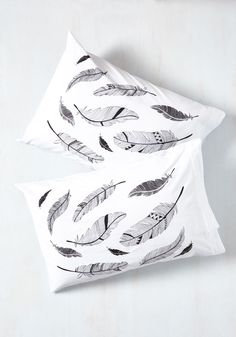 Receive the highest honors in slumber-time style with these 100% cotton pillowcases. Hand printed in the United States, this cozy white pair - adorned with artistic pen-and-ink feathers - will earn you praise and commendation each time your gals come by for the evening.