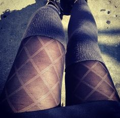 black skirt or high waisted shorts, black sheer diamond patterned tights, grey over the knee thigh high socks, and black ankle boots.