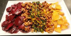 Red and golden beets with sauteed beets greens, pecans, and almonds - Chef Dana Klitzberg