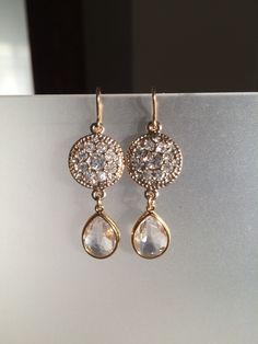 A personal favorite from my Etsy shop https://www.etsy.com/listing/164349292/dynamic-clear-crystal-and-gold-earrings