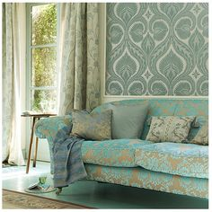#decor #home #baroque #turquoise #gold #patterns #classy #refined #decorating #couch #sofa #pillows #tapestry #wallpaper