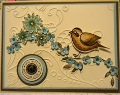 handmade card ... embossing folder texture ... layered circle tag ... spray of small punched flowers ... two step bird colred in browns ... lovely ... Stampin' Up!