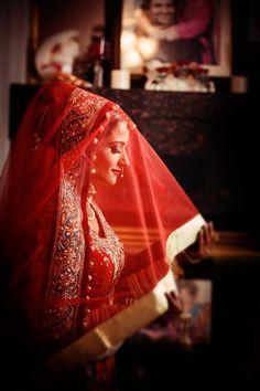 Indian wedding photography. Bridal photo shoot ideas. Indian bride wearing bridal lehenga and jewelry. #IndianBridalHairstyle #IndianBridalMakeup  Credit: Photography by Deo Studios