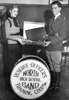 In February 1936, Pearl Sorensen was given a box of oil paints in appreciation of her work designing the Omaha North ROTC regiment's flag and drums. Presenting her with the gift from the regiment is Cadet Col. Edwards Strauss. THE WORLD-HERALD