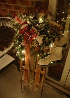 Decorate An Old Sled...with pine and lights & vintage ice skates for the front porch for the holidays. There are other fabulous ideas on this blog.  A Primitive Place.