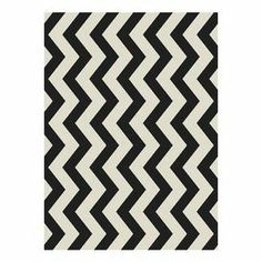"""Showcasing a chevron motif in black and beige, this loomed rug lends a pop of style to your living room or master suite.  Product: RugConstruction Material: PolypropyleneColor: Black and beigeFeatures: Suitable for indoor and outdoor usePower-loomedPile Height: 0.25"""" Note: Please be aware that actual colors may vary from those shown on your screen. Accent rugs may also not show the entire pattern that the corresponding area rugs have.Cleaning and Care: Sweep, vacuum or rinse off with a ..."""