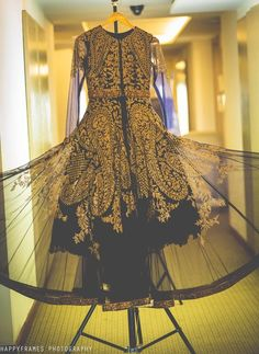 Cocktail Outfits - Gold and Black Cocktil Gown | WedMeGood | Gold Patchwork Embroidery on Net Gown #wedmegood #indianbride #cocktailoutfits #cocktail #gown #black #gold #net #indianbride #engagementoutfit