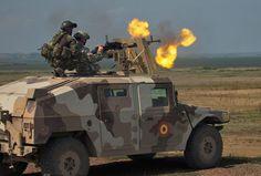 Russian Dushka heavy machine gun mounted on a Romanian HumVee. Guardsman from TN NG trying it out.
