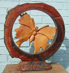 Cedar,elm,and oak Insect Sculptures, to include Bees, Ants, Moths Butterflies etc sculpture by artist David Gross titled: 'Ring fenced 2 (Big Butterfly Carved Wood garden or Yard statues)'