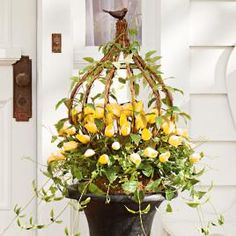 Urn Filler is an abundance of lifelike pink tulips and cascading spring vines entwined among a sculptural metal and twig arbor A delightful brow Diy Planters Outdoor, Urn Planters, Planter Ideas, Boxwood Garden, Garden Pots, Tulip Wreath, Yellow Tulips, Topiary, Spring Flowers