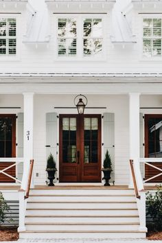 Paint it white + shutters + wooden doors!
