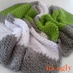 """Okay, so you need a blanket, but you've only got one weekend to make it. Or, maybe you've got plenty of time, but you are new at crochet. Or, it's for a special gentleman in your life so it has to be simple and """"manly"""" enough for him. You can get satisfy all three of these needs with the Soft Granite Blanket!"""