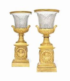 A PAIR OF CHARLES X ORMOLU AND CUT-GLASS TWO-HANDLED CAMPANA VASES ATTRIBUTED TO PIERRE-PHILIPPE THOMIRE, PARIS, CIRCA 1830.