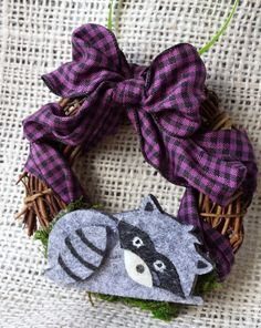 Check out this item in my Etsy shop https://www.etsy.com/listing/200965943/holiday-ornament-raccoon-wreath-racoon