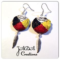 "Medicine wheel earrings with feather by Gitxsan/Nisga'a weaver Jaimie Davis. Email jada@jadacreations.net to inquire. @Jaimie Davis. Like my facebook page ""Cedar Weaving by Jaimie Davis"""