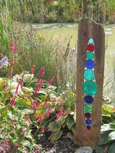 Driftwood and colored glass garden sculpture Meadow Garden, Rain Garden, Dream Garden, Garden Whimsy, Garden Junk, Garden Sheds, Glass Garden Art, Glass Art, Sea Glass