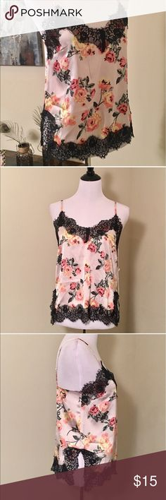 Floral Cami With Black Eyelash Lace Trim NWT. Baby pink satin cami with black eyelash lace trim and all over rose print. Side slits. Size Medium. Adjustable straps for a customized fit. 100% polyester. Beautiful🌹 Live 4 Truth Tops Camisoles