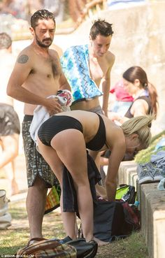 Cheking out his girl? Nathan appeared to be caught out looking at his girlfriend's backsid...