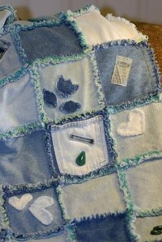 Denim Rag Quilt - love the applique patches, pockets, etc. on various squares in this quilt by aftr
