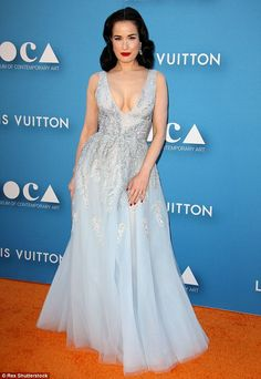 Sparkling: Dita brought her look to life with bold red lipstick, matching nail polish and ...