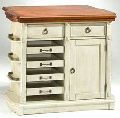 This kitchen island has a distressed white base with drawer and cubby style storage for convenience. The island has a cherry top with a carved and detailed shape for added style. The island is made with solid wood and veneers and offers a coastal inspired design.