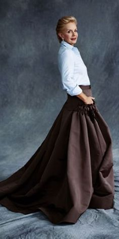 Carolina Herrera in her signature classic white blouse worn with a ball skirt