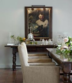 linen, silver, greenery and painting.