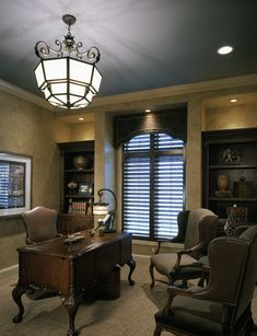 Gorgeous lighting, interesting details, and traditional styling give this home office space a luxe feel
