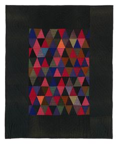 Triangles crib quilt, from the Amish quilt collection of Faith and Stephen Brown.