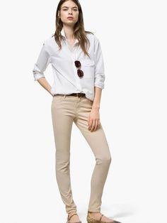 Tan trousers, white shirt, aviators & loafers