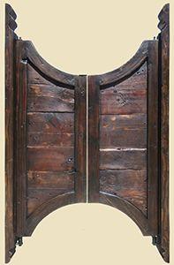 Saloon doors with carved jams from La Puerta Originals - via @Marilyn Pleadwell - #WesternHome