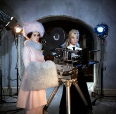 Geraldine Chaplin and Julie Christie in costume during a break in filming for 'Doctor Zhivago' (1965).