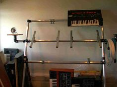 Keyboard stand made out of Kee Klamp fittings. See more industrial pipe structures at http://www.simplifiedbuilding.com/projects/category/structures/ #KeeKlamp #industrialpipe #structure
