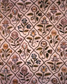 Detail.  Part of a long cover | Museum of Fine Arts, Boston.  English.  Early 17th C.  Polychrome silk and gilt-silver yarns embroidered on undyed linen ground. Pattern of eight individual floral slips repeated throughout, divided from one another by diamond lattice-work of gilt-silver yarns. Gilt-silver border at top and both sides. Cut across bottom. Other part of this embroidery is in the Metropolitan Museum of Art.