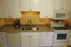 "n this kitchen we used Waypoint Living Spaces Cabinetry 720F Door and New Venetian Gold Granite countertops with a 4"" tall backsplash."