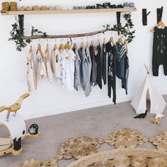 love the wood idea to hang some clothes.  sticks with the natural feel