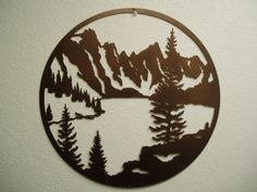 A beautiful mountain lake scene, 20 inches in diameter, plasma cut from heavy gauge steel, shown in a copper vein, powder coat finish. Description from etsy.com. I searched for this on bing.com/images